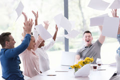 Multiethnic startup Group of young business people throwing docu. Multiethnic Group of young business people throwing documents and looking happy while Stock Photography