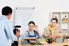 Multiethnic teenagers shooting video blog about engineering. At home stock photos