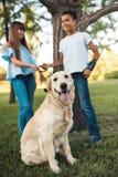 Multiethnic teens with dog Stock Photos