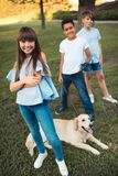 Multiethnic teens with dog Stock Photography