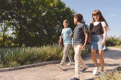 Multiethnic teens walking in park Stock Images