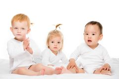 Multiethnic toddler boy and girls. Multiethnic toddler asian boy and caucasian girls isolated on white stock images