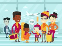 Multiethnic tourists standing in airport in winter Stock Image