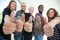 Multiethnic University Students Gesturing Thumbsup Stock Photography