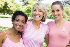 Multiethnic volunteers participating in breast cancer awareness Stock Image