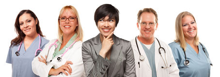 Multiethnic Woman with Doctors and Nurses Behind stock images