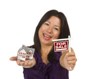 Multiethnic Woman Holding Real Estate Sign, House. Multiethnic Woman Holding Small For Sale Real Estate Sign and House in Hand Isolated on White Background Stock Image