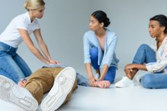 multiethnic women on first aid training, royalty free stock image