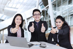 Multiethnic workers with thumbs up Stock Photography