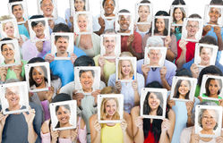 Multiethnic World People Holding the Tablet Royalty Free Stock Photography