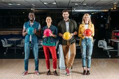 multiethnic young friends holding balls stock photography