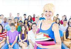 Multiethnic young people in lecture room Stock Photo