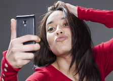 Multiethnic young woman's pout for selfie Stock Photos