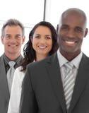 Multiethnische Geschäftsgruppe, die Kamera betrachtet Lizenzfreies Stockbild