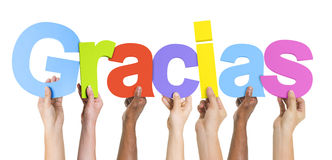 Multiethnische Gruppe Hände, die Gracias halten Lizenzfreie Stockbilder