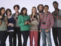 Multietnisk grupp människor med kameror Fotografering för Bildbyråer