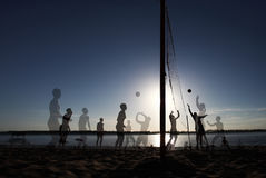 Multiexposition beach Volleyball at Sunset Enjoyment Concept royalty free stock photography