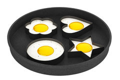 Multiform Fried Eggs in Pan Stock Photos