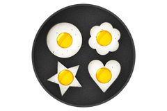 Multiform Fried Eggs in Pan Royalty Free Stock Photos
