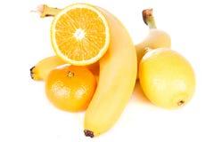 Multifruit. Lemon, banana, sliced orange and tangerine  on white background Royalty Free Stock Image