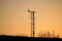 Multifunctional antenna. In London suburb at  dusk; silhouette Stock Photos