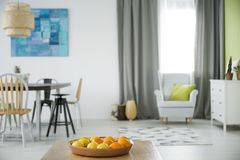 Multifunctional apartment with armchair. Dresser, table and chairs stock images