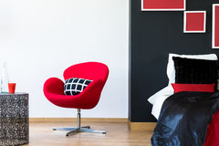 Free Multifunctional Bedroom With Red Chair Royalty Free Stock Image - 98975716