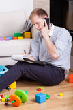 Multifunctional dad talking on the phone Royalty Free Stock Photos