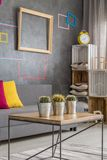 Multifunctional home space. In grey with creative decorations royalty free stock photo