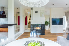 Multifunctional living room interior. With stylish fireplace royalty free stock photography