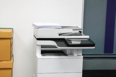Multifunctional office laser printer for use in scanning and printing business documents in workplace royalty free stock photos