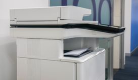 Multifunctional office printer for in scanning printing documents at workplace royalty free stock images