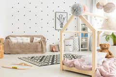 Multifunctional white child room. Multifunctional, black and white child room with bed, couch, carpet royalty free stock image