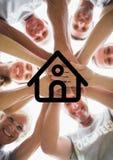 Multigeneration семья при их руки штабелированные против плана дома в предпосылке Стоковая Фотография RF