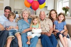 Multigeneration family celebrating girls birthday Stock Photography