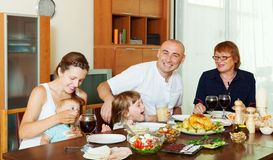 Multigeneration family communicate over holiday table Royalty Free Stock Images
