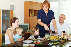 Multigeneration family communicate over  table Stock Image