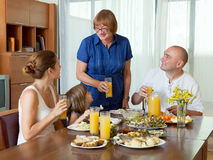 Multigeneration family communicate over  table Royalty Free Stock Image