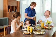 Multigeneration family communicate over  table Royalty Free Stock Photos