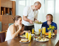 Multigeneration family  eating at home Royalty Free Stock Photo