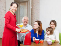 Multigeneration family having breakfast Royalty Free Stock Photos
