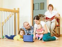 Multigeneration family at home Stock Images