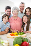 Multigeneration family preparing food at counter Stock Photography