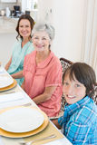 Multigeneration family sitting at dining table Royalty Free Stock Photography