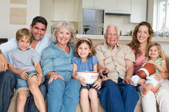 Multigeneration family spending leisure time. Portrait of smiling multigeneration family spending leisure time together at home Stock Images