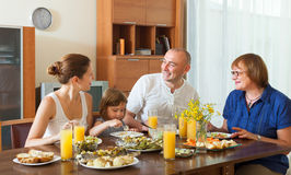 Multigeneration family together around table. Portrait of smiling multigeneration family together around festive table Stock Image