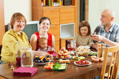Multigeneration family  together over celebratory table Stock Photography