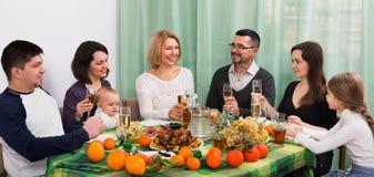 Multigenerational big family sitting at holiday table Royalty Free Stock Photo