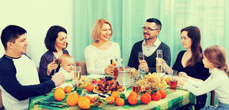 Multigenerational big family sitting at holiday table Stock Images