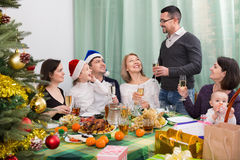 Multigenerational cheerful family sitting at festive table Royalty Free Stock Photography